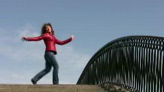 Girl dance on bridge Stock Footage