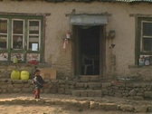 Sherpa toddler infront of house Stock Footage