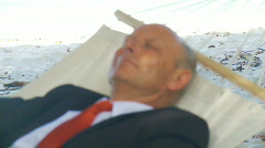 Shot transition senior manager in hammock Stock Footage