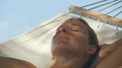 Closeup of sleeping woman in hammock Stock Footage