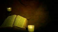 Dolly bible candles Stock Footage