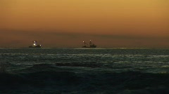 Fishing boats off the shore. - stock footage