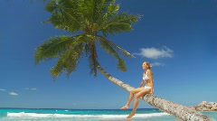 woman relaxing on palmtree - stock footage