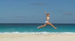 Slomo of jumping woman Stock Footage
