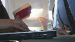 Stock Video Footage of Female hands type on laptop keyboard aboard airplane