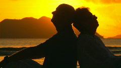 Elderly couple at sunset closeup Stock Footage