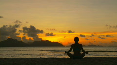 Yoga silhouette at sunset Stock Footage