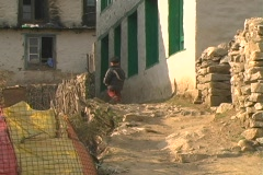 Kid walks in Namche Bazaar Stock Footage