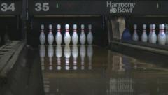 Low angle shot of bowling ball knocking down pins Stock Footage