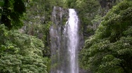 Zoom out from tropical waterfall Stock Footage