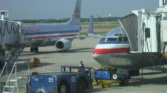 Busy airport workers prepare planes for departure. Stock Footage