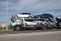 Large truck delivers new cars - stock footage