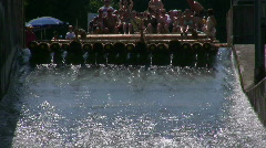 Tradition Wooden Rafts sliding down canal Germany Bavaria  Stock Footage