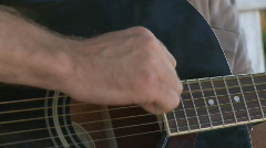 Guitarist hand playing acoustic guitar Stock Footage