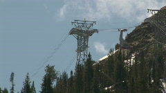 Trams cross at top tower Snowbird resort M HD Stock Footage