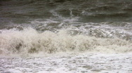 Stock Video Footage of Waves from a rough sea crash onto a beach in Dorset England