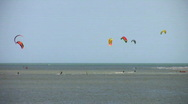 Stock Video Footage of Sea water sport para-kite-surfing at Exmouth Devon England