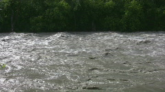 Raging river shot from riverbank - stock footage