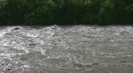 Stock Video Footage of Raging river shot from riverbank