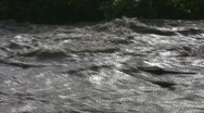 Stock Video Footage of Lifesaver ring rushes by in flooding river