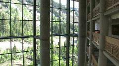 Resort lobby mountain pan left across window to mountain Stock Footage
