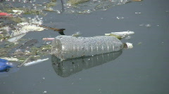 Floating garbage - water bottle. Stock Footage