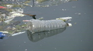 Stock Video Footage of Floating garbage - water bottle.