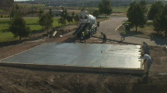 Concrete workers put fininshing touches on newly poured floor. Stock Footage