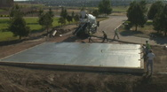 Stock Video Footage of Concrete workers put fininshing touches on newly poured floor.
