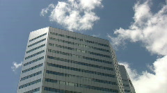 Silver office building. Real time clouds. Stock Footage