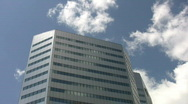 Stock Video Footage of Silver office building. Real time clouds.