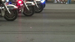 Police bikes driveby Stock Footage