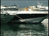 Stock Video Footage of Motor Yacht leaving harbor