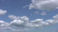 White fluffy cumulus clouds. Light time lapse. Stock Footage