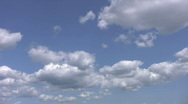 Stock Video Footage of White fluffy cumulus clouds. Light time lapse.