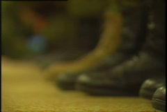 Military, army boots rack focus Stock Footage