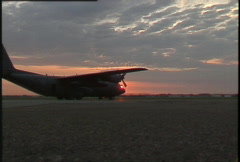 Military, C130 Hercules on tarmac zoom in Stock Footage