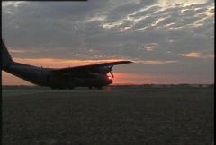 military, C130 Hercules on tarmac zoom in - stock footage