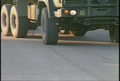 Truck into camp closeup wheels Stock Footage