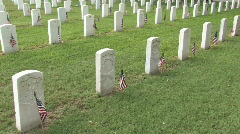 Memorial Day Vet Cem flags pan left M HD Stock Footage