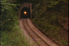 Train exits tunnel Stock Footage