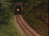 Stock Video Footage of Train exits tunnel