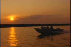 Sunset fishing boat - stock footage