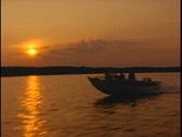 Sunset fishing boat Stock Footage