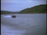 Speeding fishing boat Stock Footage