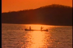 Fishing from a canoe - stock footage