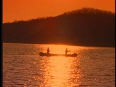 Fishing from a canoe Stock Footage