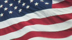 Closeup of real USA flag waving against dark blue sky Stock Footage