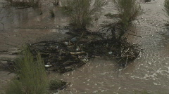 Polution in a flooded wash - stock footage