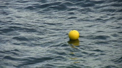 Lost yellow ball on cold blue water. Stock Footage